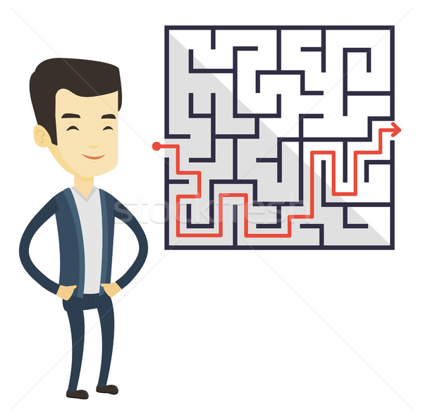Business man looking at labyrinth with solution. Stock photo © RAStudio