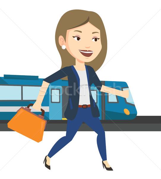 Zakenvrouw treinstation kaukasisch zakenvrouw lopen trein Stockfoto © RAStudio
