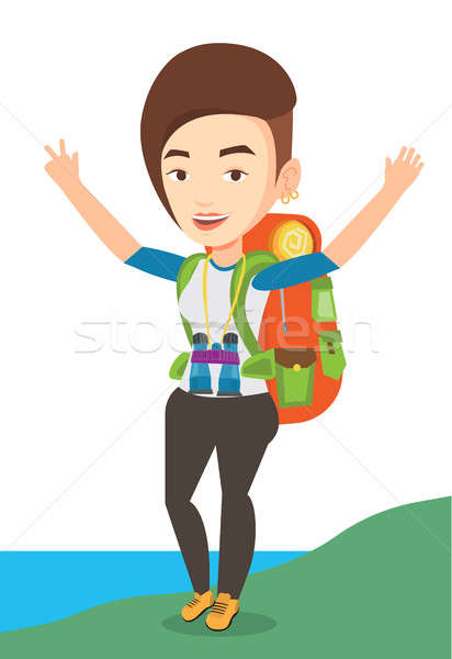 Backpacker with her hands up enjoying the scenery. Stock photo © RAStudio