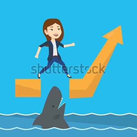 Business man jumping over ocean with shark. Stock photo © RAStudio