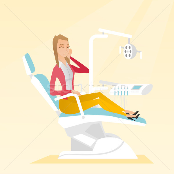 Woman suffering from toothache. Stock photo © RAStudio