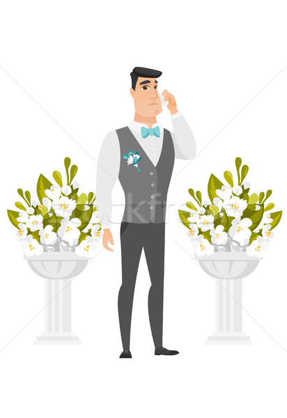 Caucasian groom crying during wedding ceremony. Stock photo © RAStudio