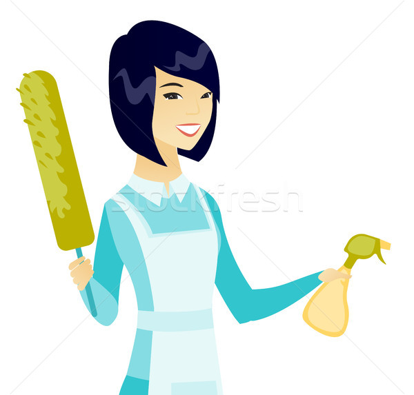 Asian housemaid holding spray bottle and duster. Stock photo © RAStudio
