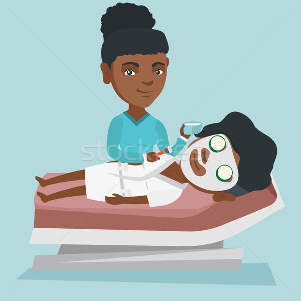 Vrouw procedure schoonheidssalon afrikaanse cosmetische Stockfoto © RAStudio