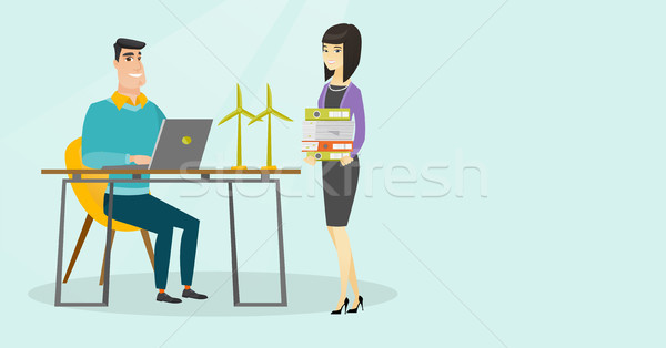 Multicultural engineers projecting wind turbines. Stock photo © RAStudio