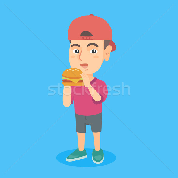 Kicsi kaukázusi fiú eszik hamburger étvágy Stock fotó © RAStudio