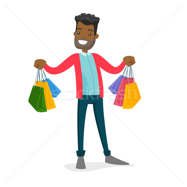 African-american consumer holding shopping bags. Stock photo © RAStudio