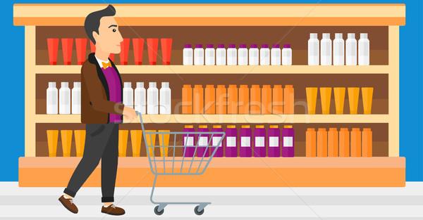 Klant man voortvarend lege supermarkt winkelwagen Stockfoto © RAStudio