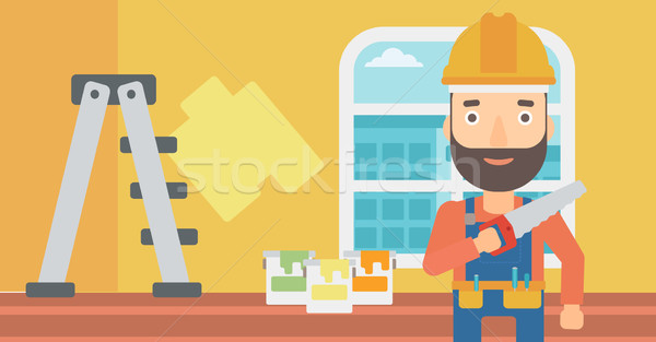 Stock photo: Smiling worker with saw.