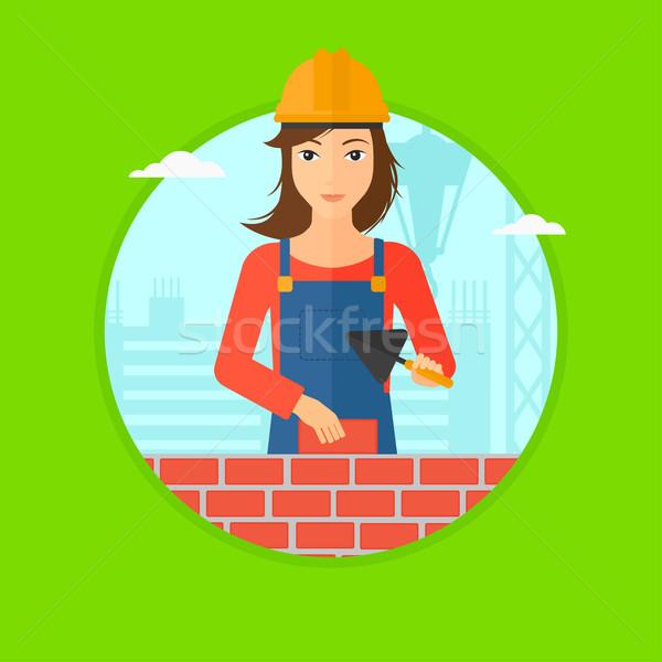 Murarz cegły kobiet uniform Zdjęcia stock © RAStudio