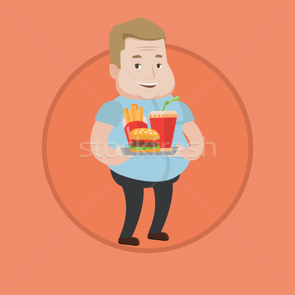 Man holding tray full of fast food. Stock photo © RAStudio