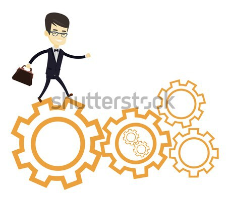 Business woman running on cogwheels. Stock photo © RAStudio