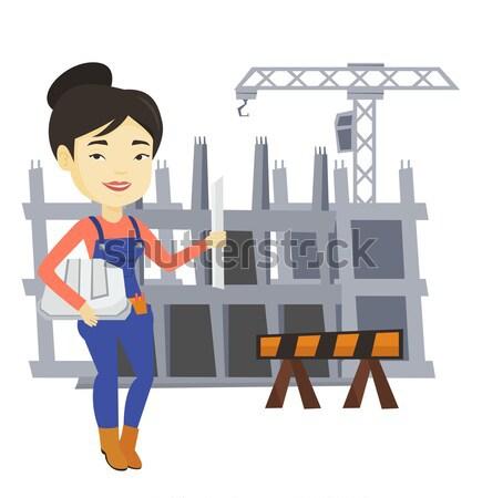 エンジニア ヘルメット 青写真 小さな アジア 立って ストックフォト © RAStudio