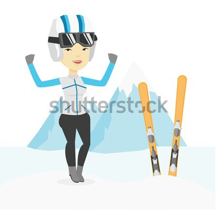 Cheerful skier standing with raised hands. Stock photo © RAStudio