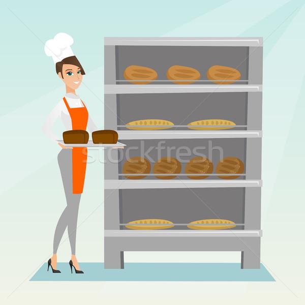 счастливым молодые Бейкер лоток хлеб Сток-фото © RAStudio