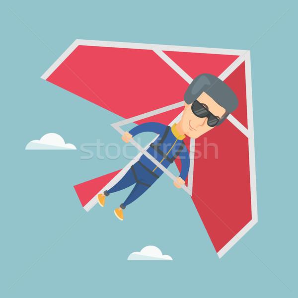 Man flying on hang-glider vector illustration. Stock photo © RAStudio