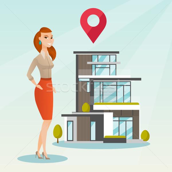Pośrednik w sprzedaży nieruchomości domu Pokaż uśmiechnięty Zdjęcia stock © RAStudio