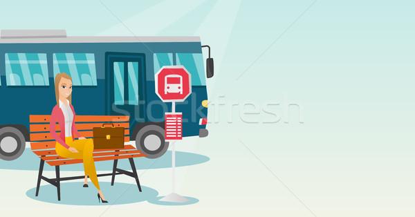 Caucasiano mulher espera ônibus parada de ônibus empresária Foto stock © RAStudio