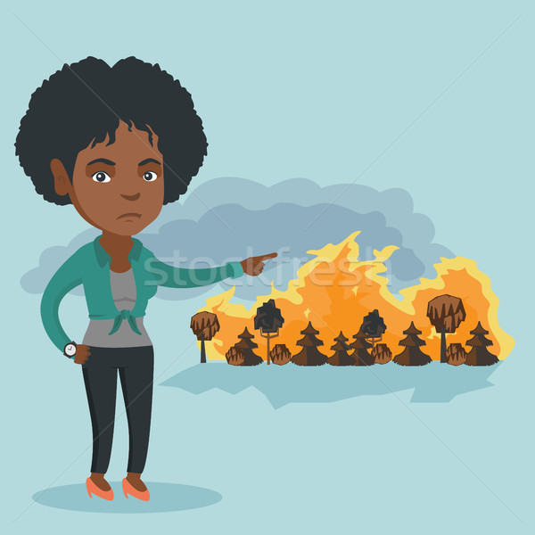 женщину Постоянный wildfire молодые африканских указывая Сток-фото © RAStudio