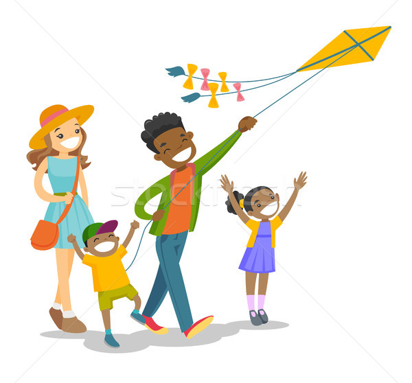 Young multiethnic family playing with a kite. Stock photo © RAStudio