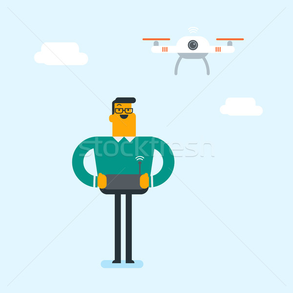 Young caucasian white man flying drone. Stock photo © RAStudio