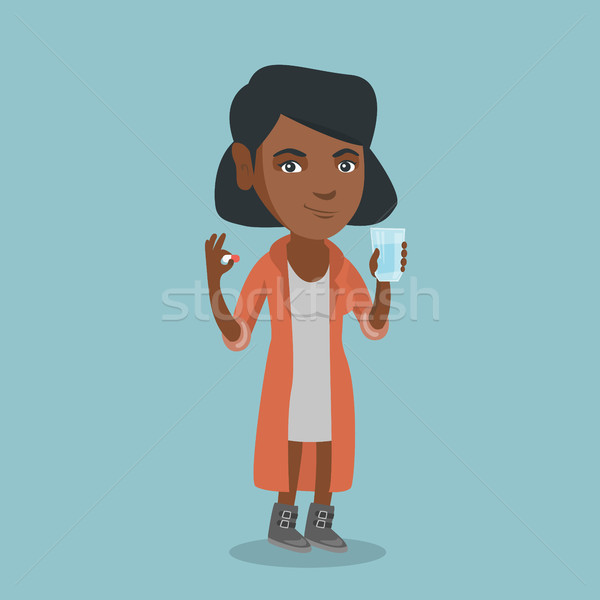 Young african-american woman taking pills. Stock photo © RAStudio