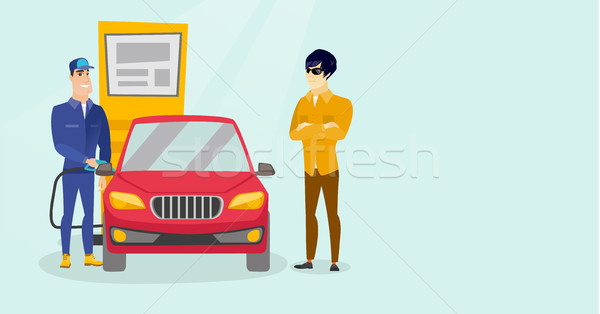 Caucasian white worker filling up fuel into car. Stock photo © RAStudio
