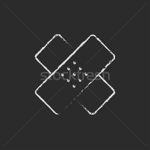Adhesive bandages icon drawn in chalk. Stock photo © RAStudio