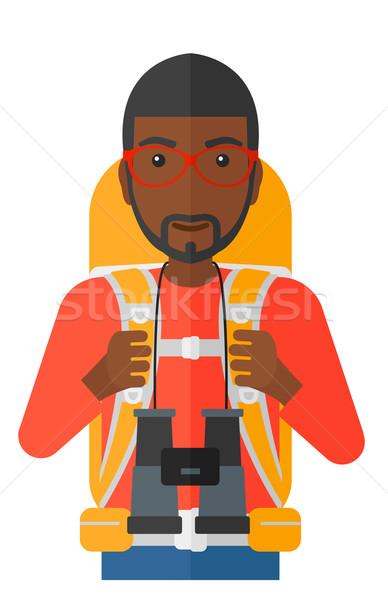 Wesoły backpacker lornetki człowiek plecak turystyka Zdjęcia stock © RAStudio