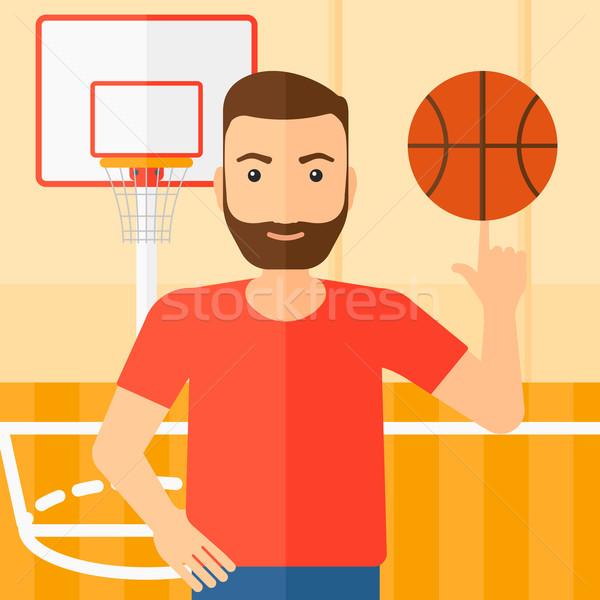 Basketball player spinning ball. Stock photo © RAStudio
