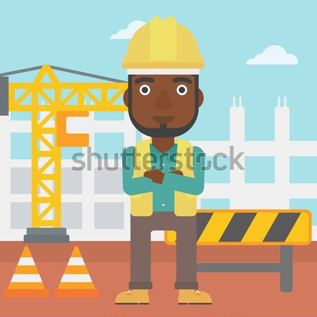 Friendly builder with arms crossed. Stock photo © RAStudio
