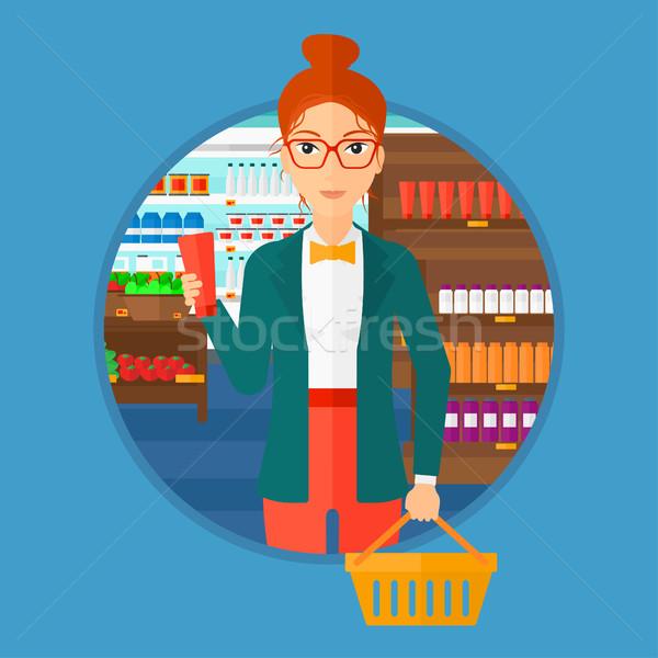 Vásárló bevásárlókosár cső krém fiatal nő tart Stock fotó © RAStudio