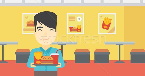 человека лоток полный быстрого питания азиатских молодым человеком Сток-фото © RAStudio