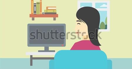 Kadın izlerken tv Asya genç kadın oturma Stok fotoğraf © RAStudio