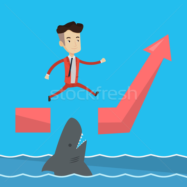 Businessman jumping over ocean with shark. Stock photo © RAStudio