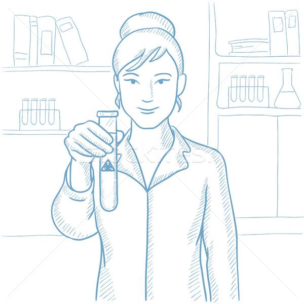 Scientist holding test tube with biohazard sign. Stock photo © RAStudio