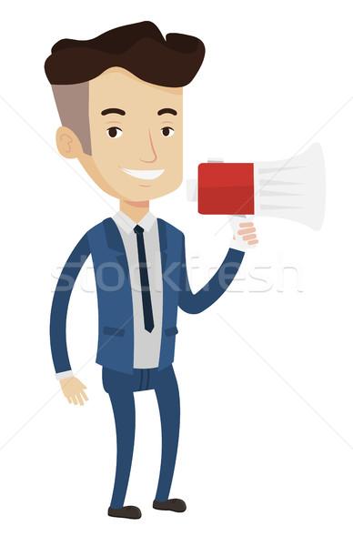 Businessman speaking into megaphone. Stock photo © RAStudio