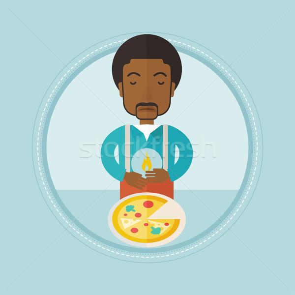 Uomo sofferenza bruciore di stomaco mangiare pizza sconvolto Foto d'archivio © RAStudio