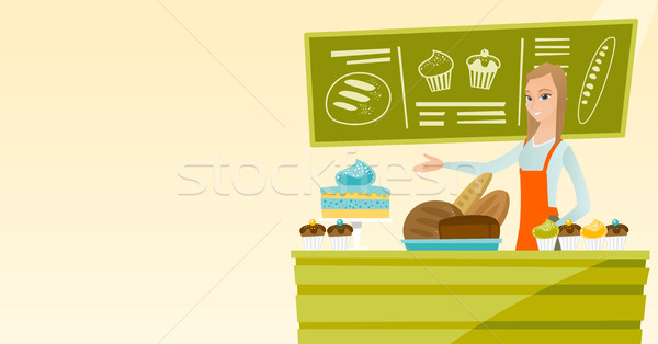 Worker standing behind the counter at the bakery. Stock photo © RAStudio