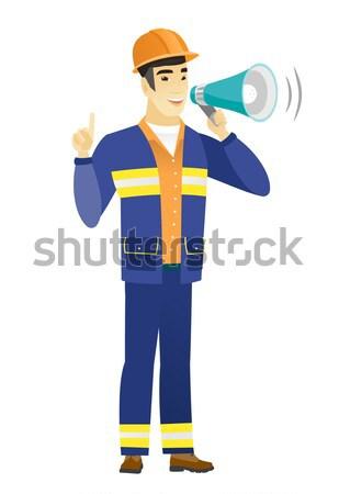 Jonge kaukasisch brandweerman aankondiging megafoon Stockfoto © RAStudio