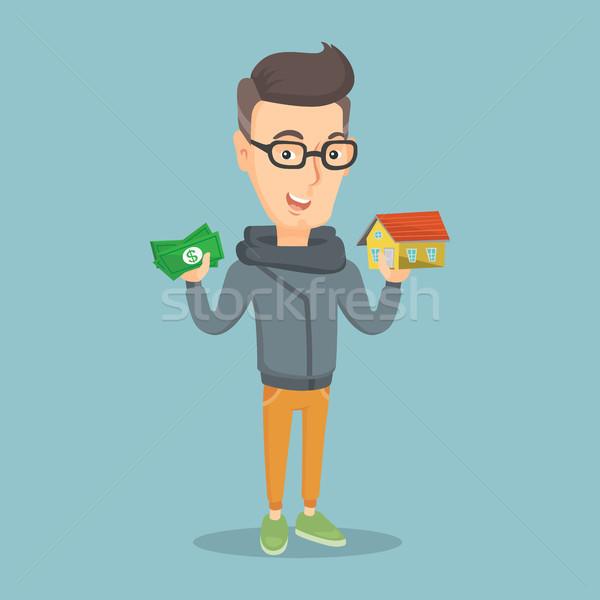 Kaukasisch man kopen huis dank lening Stockfoto © RAStudio