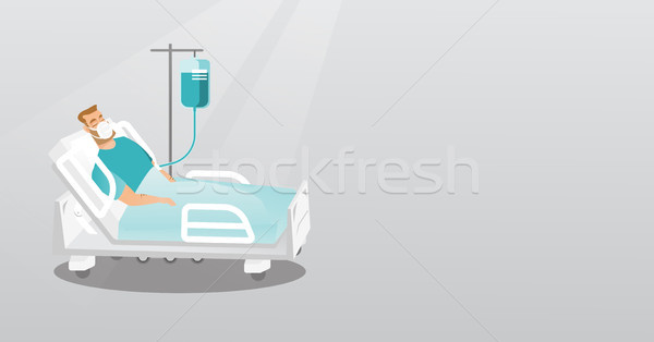 Patient lying in hospital bed with oxygen mask. Stock photo © RAStudio