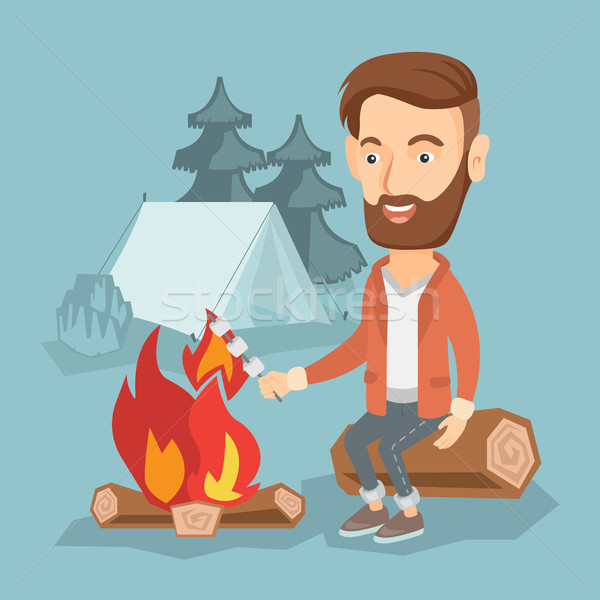 Businessman roasting marshmallow over campfire. Stock photo © RAStudio