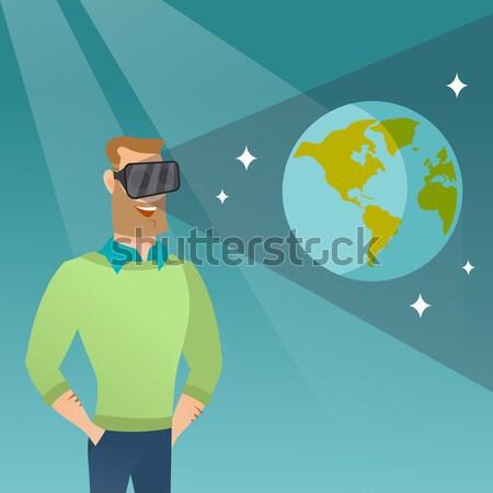 Caucasian man in vr headset getting in open space. Stock photo © RAStudio