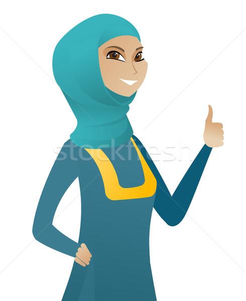 Young muslim business woman giving thumb up. Stock photo © RAStudio