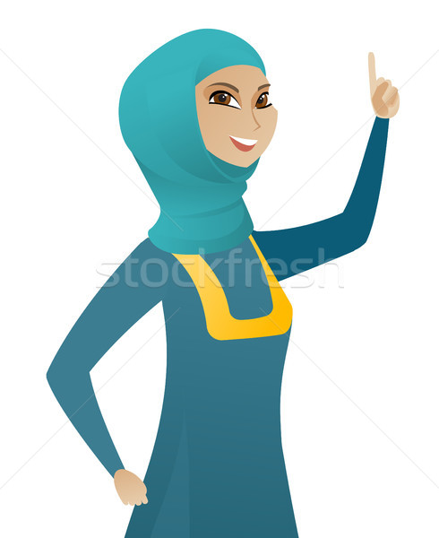 Young muslim business woman pointing her finger up Stock photo © RAStudio