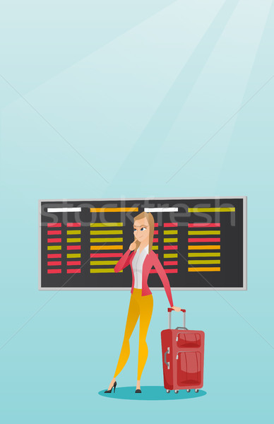 Woman looking at departure board at the airport. Stock photo © RAStudio