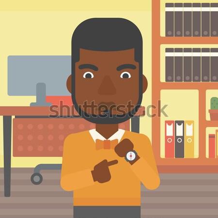 Mérges üzletember mutat karóra áll iroda Stock fotó © RAStudio