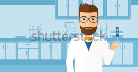 Laboratory assistant with syringe in lab. Stock photo © RAStudio