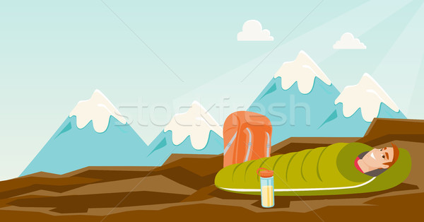 Man sleeping in a sleeping bag in the mountains. Stock photo © RAStudio